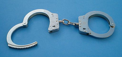 "CC BY-SA 2.5-2.0-1.0 <a href=""https://commons.wikimedia.org/wiki/File:Handcuffs01_2003-06-02.jpg""> via Wikimedia Commons</a>"